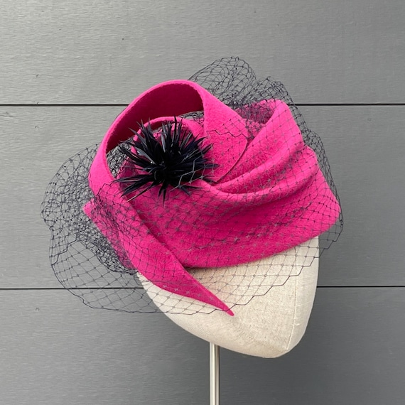 Fuchsia pink velour felt toque with navy veiling and spiky feather pompom
