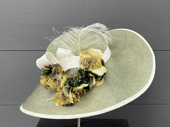 Sage green large-brimmed straw hat with vintage silk flowers, burnt ostrich feather, and straw band and loops
