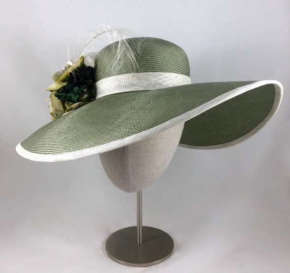 Gorgeous sage green large-brimmed straw hat with vintage silk flowers, burnt ostrich feather, and straw band and loops