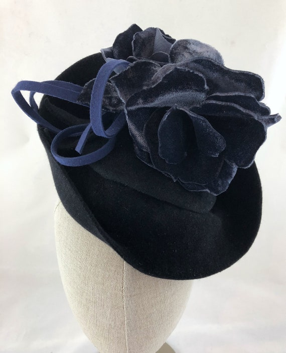 Hand-sculpted black velour felt perching hat with blue velvet roses and blue felt loops