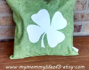hand made green embellished decorative 14x14 pillow with a white shamrock in vinyl