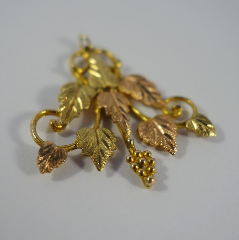 Black Hills Gold Ornate Pendant ~ 8 leaves and grape bunch swirled vine accents