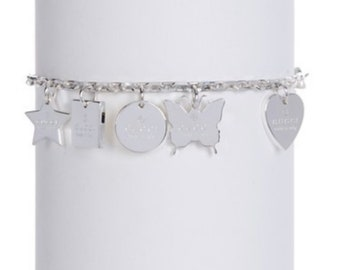 176555630 Authentic Gucci Sterling Silver Heart Butterfly Trademark Charm Bracelet, Gucci  Bracelet, Charm Bracelet, Silver Bracelet, Gucci Jewelry