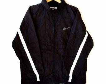 5769e44cac0292 Rare!!! Vintage NIKE SWOOSH SPORTSWEAR Small Logo Windbreaker Jacket Black  Colour Medium Size