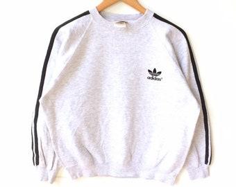 99e63c130a85 Rare!!! Vintage ADIDAS TREFOIL CANADA Crewneck Sweatshirt Made in Canada  Light Grey Colour Medium Size