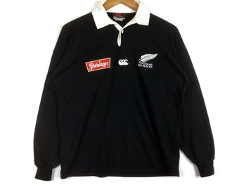 a2849d18dc8 The Famous CANTERBURY Of NEW ZEALAND Steinlager Polo Rugby Sweatshirt Black  And White Colour Small Size