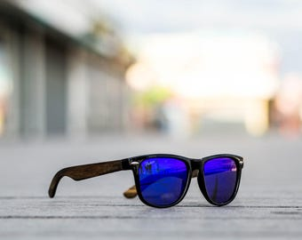 29038c1550a Polarized sustainable wooden wayfarer style blue lens sunglasses with a  strong polycarbonate frame and UV400 protection