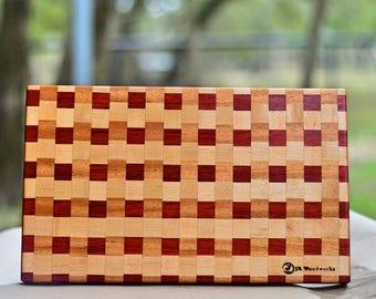 Padauk, maple and mahogany cutting board