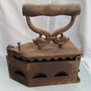 Old antique primitive hand coal iron for clothes with wooden handle