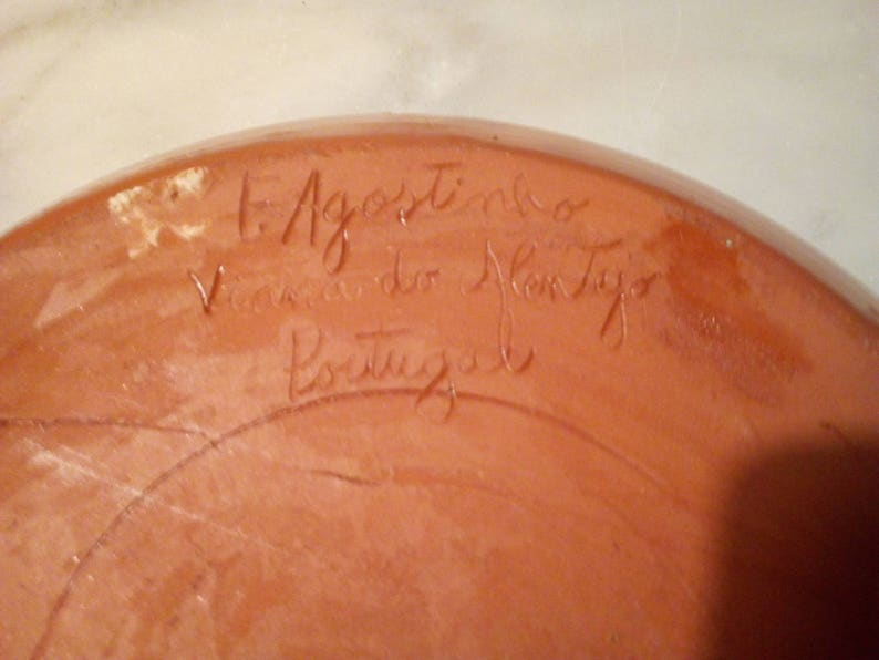 Signed the Portugal earthenware plate