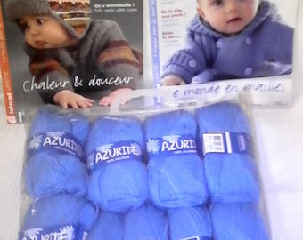 8 balls of blue wool and two journals layette