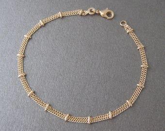 a5db33de1014 Bracelet double chaîne clips plaqué or 750 000 18 carats