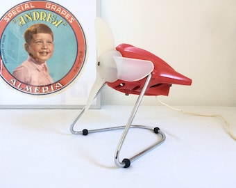 Small red 1970s electric table fan