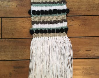 Turquoise, grey, black and cream woven wall art