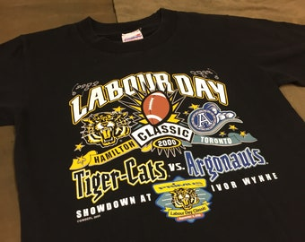 CFL Hamilton Tiger Cats vs Toronto Argonauts Labour Day Classic Vintage  T-Shirt c54ca5189