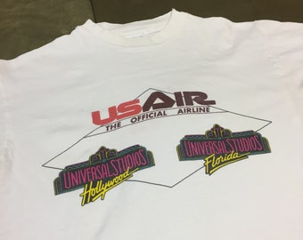 490a7652b19ca2 90s US Air The Official Airline of Universal Studios Hollywood Florida Vintage  T Shirt