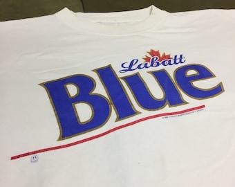 a3b83048 Thrashed 90s Labatt Blue Beer Logo Vintage T Shirt
