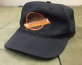 300d95b009fab3 90s NHL Vancouver Canucks Logo 7 Black Vintage Hat