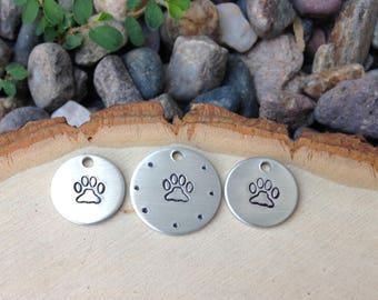 Hand stamped dog paw prints - set of 3 stamped discs