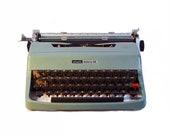 Typewriter. Vintage Olivetti Lettera 32. Blue.
