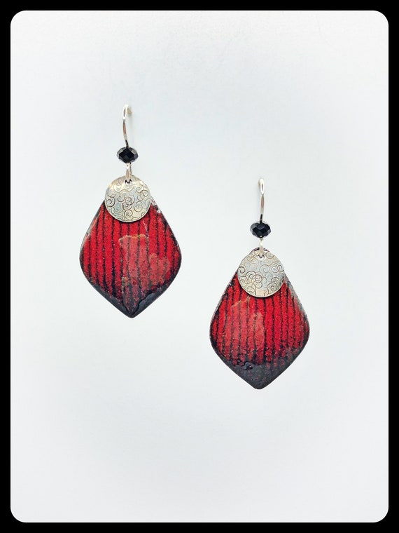 Domed enameled copper drop earring in red and black