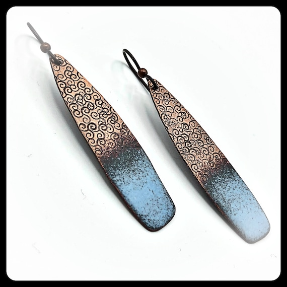 Matte finished blue gray enamels on copper