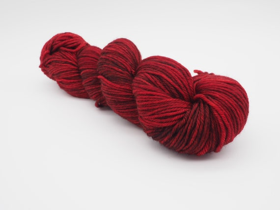After party - tonal red hand-dyed semi-solid superwash DK (8 ply) merino yarn - 100g (225m)