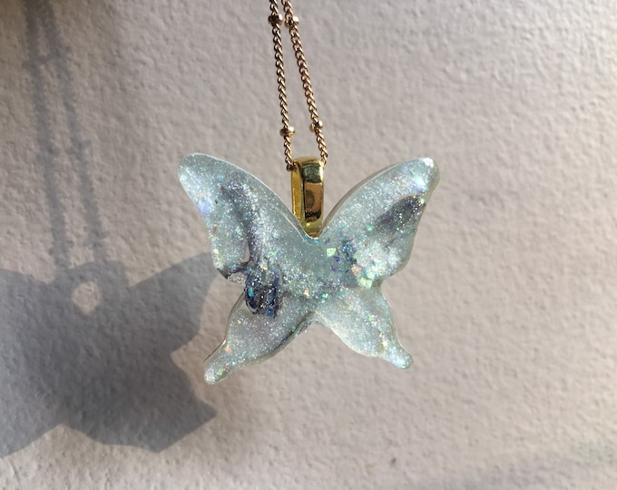Butterfly Amulet 2 - Larkspur Flowers, Rainbow Moonstone and Glow in the Dark Opal Dust - Long Gold Chain