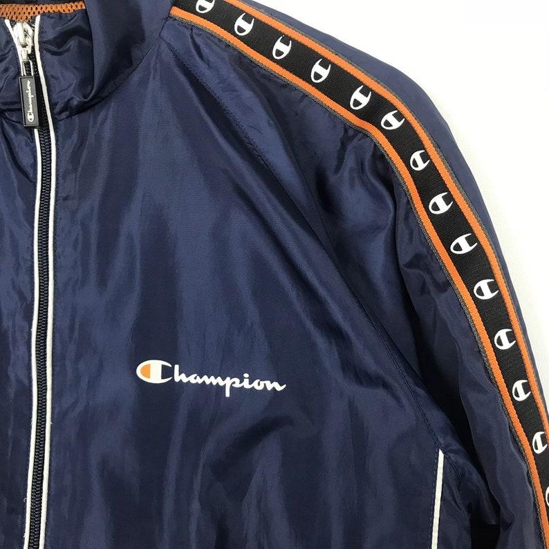 Vintage CHAMPION Jacket Spellout Big Logo Side Tape Design Sportwear Nice Design Multicolour Sweater Retro Rap tees Hip Hop Swag Rare !!