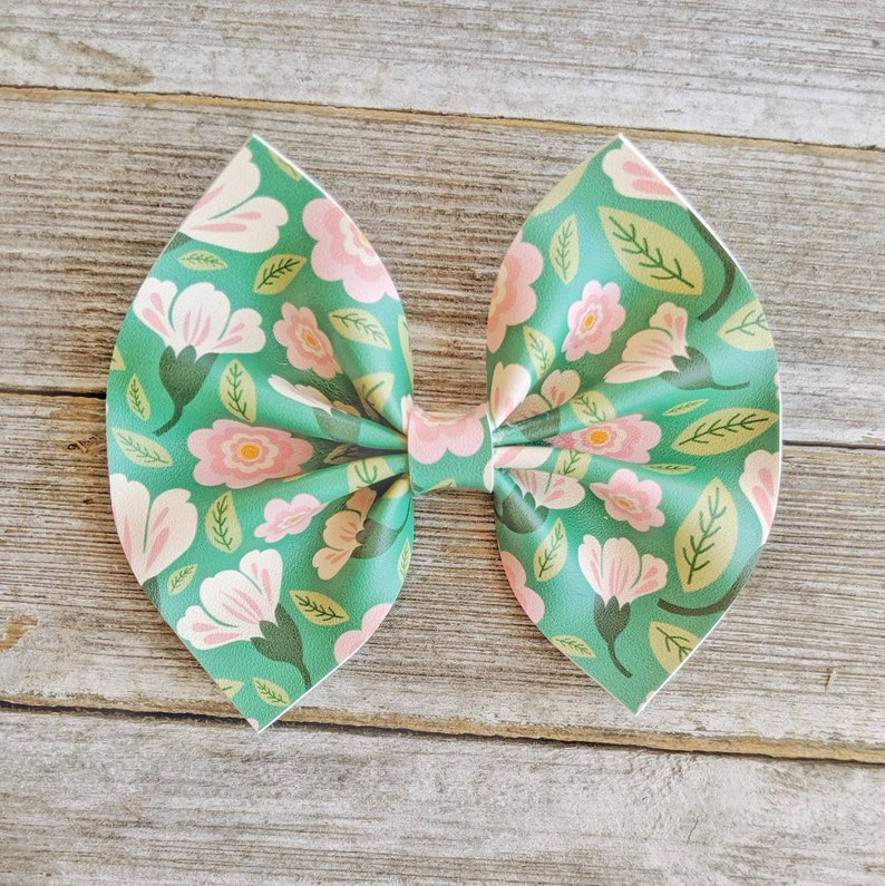 Floral leather bows