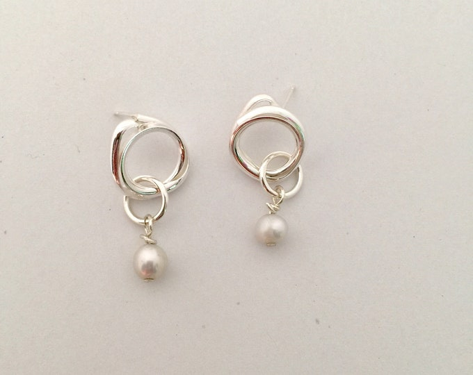 Mila stud drops with freshwater pearl charm.