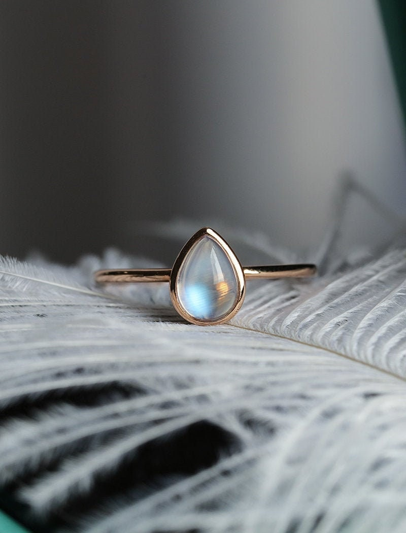 Engagement ring rose gold pear shaped moonstone bezel set image 0