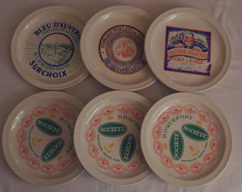 St Amand, 6 cheese from the 50s, a white background, pattern publiciatire plates