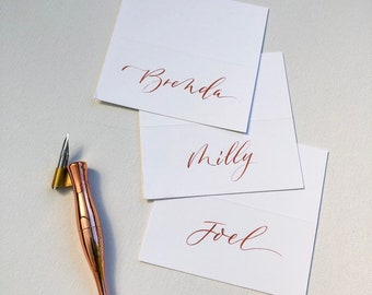 Wedding or party place cards with custom hand lettered calligraphy in gold or copper ink, by cnbcalligraphy, Sydney special events