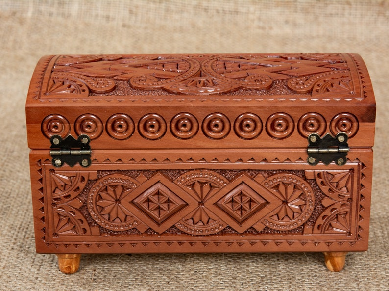 Small wooden jewelry box with hinget lid hand carved from pear wood