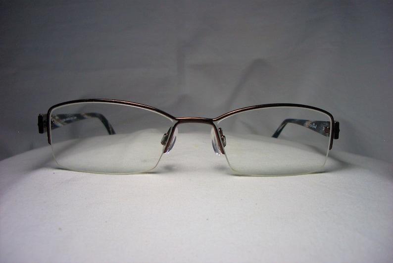 35b8ac4af5b Cogan eyeglasses half rim frames oval square men s