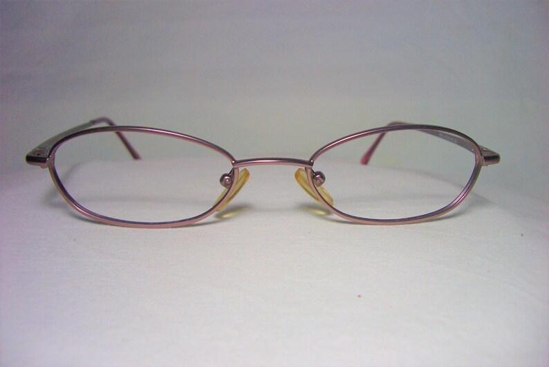 9dbeaf90189 Cap 18 eyeglasses frames Titanium alloy oval men s
