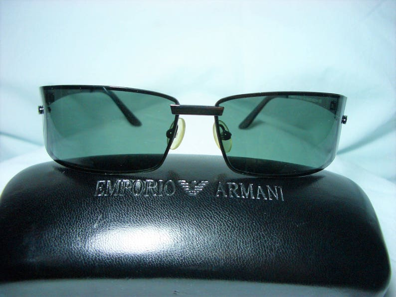 7802079e7f94 Emporio Armani Italy wrap around sunglasses frames