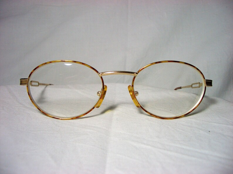 a661bf2cce0 Gia eyeglasses round oval 22 kt gold plated frames