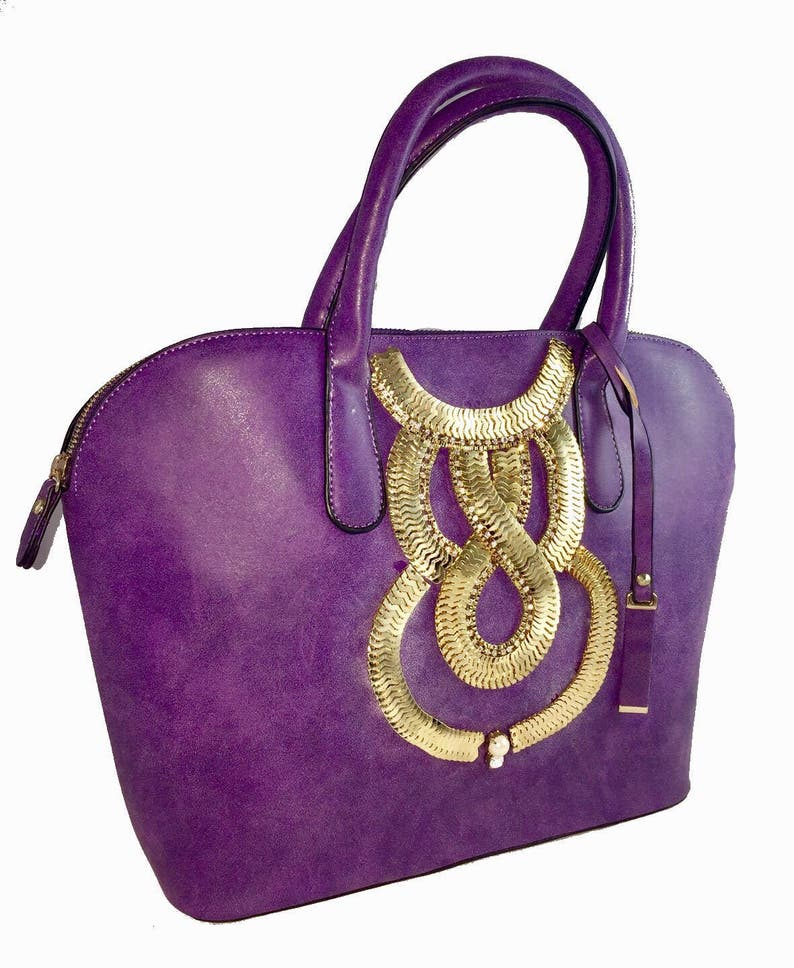 purple faux leather tote bag with gold embellishment