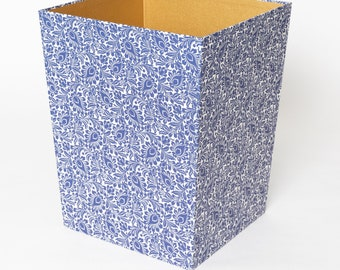 Trash covered with coloured paper in dark blue