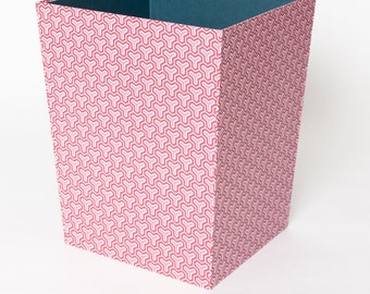 Trash covered with coloured paper in pink