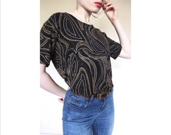 071d310673f76 Vintage sparkly giltter gold and black swirl shirt