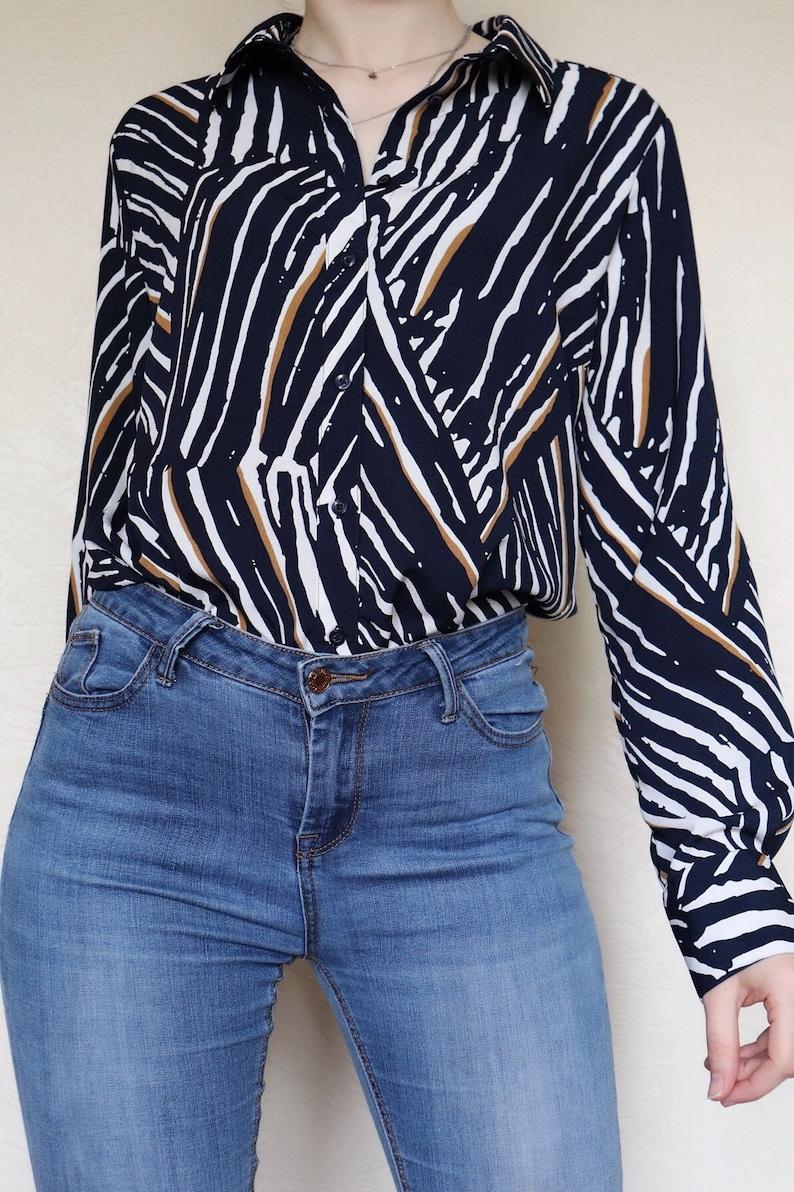 Vintage blue white and gold zebra striped animal print long sleeved patterned blouse
