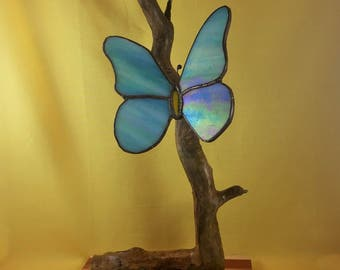 stained glass blue butterfly on natural wooden stand