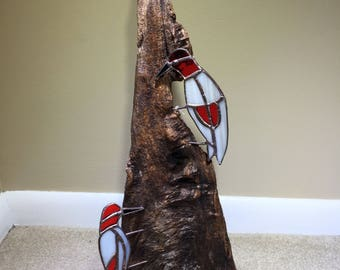 Stained glass woodpeckers on driftwood