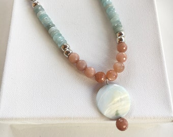Peach moonstone and aquamarine beaded necklace with shell pendant.  Textured silver chain. Chain and beaded necklace. Shell pendant.