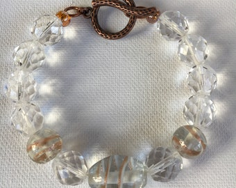 Toggle bracelet with clear crystal faceted beads and copper accent foil beads. Beaded toggle bracelet. Crystal bracelet. Beaded bracelets.