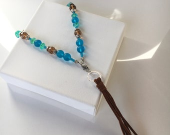 Caribbean aqua colored beaded necklace with or with out the leather tassel. Turquoise colored beaded jewelry. Beaded necklaces. Necklaces.