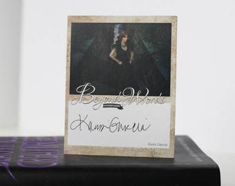 Signed Kami Garcia book plate featuring image from the 2016 Beyond Words fantasy author calendar